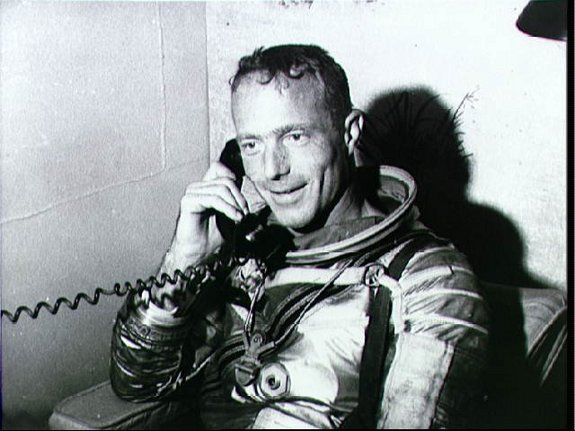 Astronaut M. Scott Carpenter, prime pilot for the Mercury-Atlas 7 (MA-7) mission, talks with President John F. Kennedy via radio-telephone from aboard the carrier U.S.S. Intrepid. Carpenter was recovered by a helicopter and taken to the U.S.S. Intrepid after a 4 hour and 56 minute mission in space.