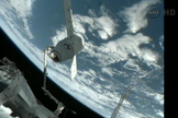 The Canadarm2 of the International Space Station was used to position the Dragon spacecraft for docking, May 25, 2012.