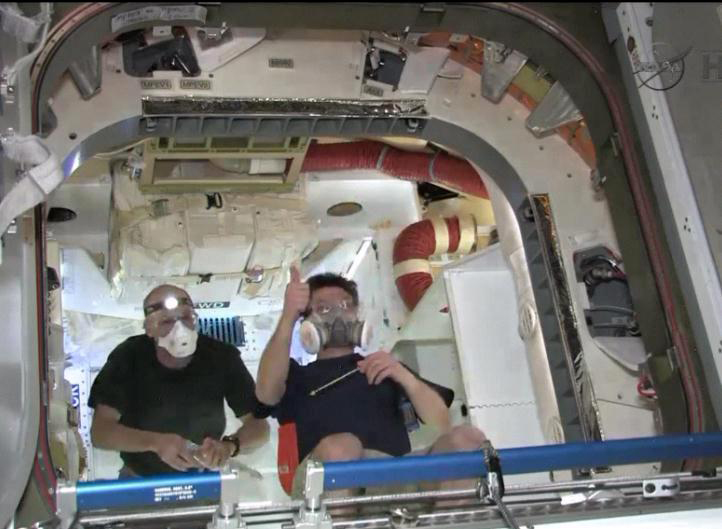 Astronauts Inside SpaceX's Dragon Capsule