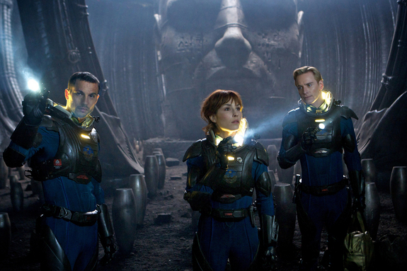 "Logan Marshall-Green, left, Noomi Rapace, and Michael Fassbender explore a planet in the darkest corners of the universe, in ""Prometheus."" Opening date: June 8, 2012."