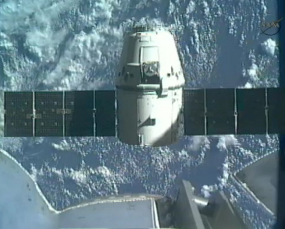 SpaceX's first Dragon space craft to the International Space Station backs away from the Canadarm2 robotic arm on the orbiting lab to begin the return trip to Earth on May 31, 2012, in this still from a NASA broadcast.
