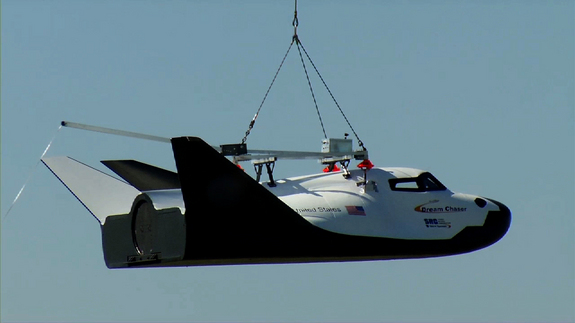 Sierra Nevada Corporation (SNC) Space Systems' Dream Chaser flight vehicle is lifted by an Erickson Air-Crane helicopter near the Rocky Mountain Metropolitan Airport in Jefferson County, Colo., on May 29, during a captive-carry test.