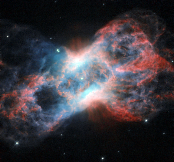 NGC 7026, a planetary nebula, lies just beyond the tip of the tail of the constellation of Cygnus (The Swan).
