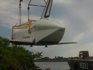 Shuttle Enterprise Lifted onto Barge