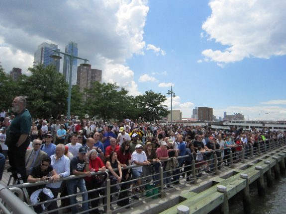 Hundreds of enthusiastic people watched as the space shuttle Enterprise arrived at its new home: New York City's Intrepid Sea, Air and Space Museum, June 6, 2012.