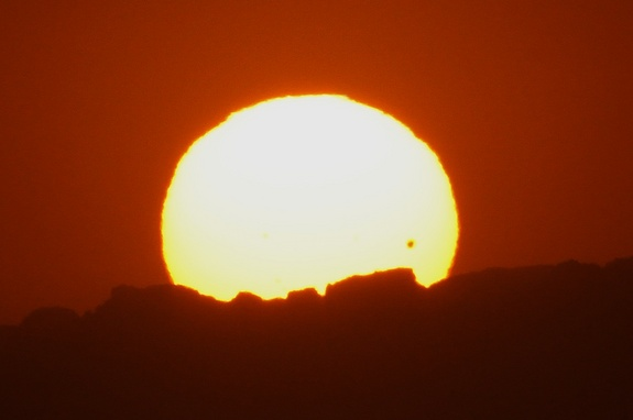 Dena Sparks of Hermosa Beach, Calif., shot this scene of the sun and Venus setting behind the Malibu Mountains from Manhattan Beach on June 5, 2012. Sparks used a Canon EOS 7D DSLR camera and 70–200 mm telephoto lens with a 2x teleconverter.
