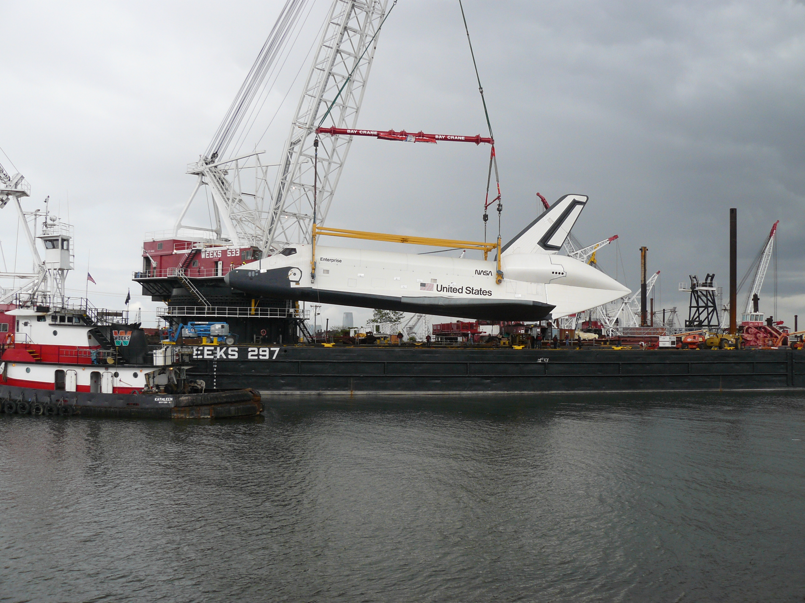 Enterprise Being Hoisted by Crane