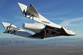 Virgin Galactic's first SpaceShipTwo spacecraft, the VSS Enterprise, glides over California's Mojave Air and Space Port in this view from a series of unpowered flight tests.