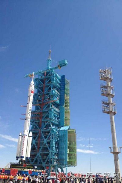 This image released by the China Manned Space Engineering Office shows the Long March 2F rocket carrying the Shenzhou 9 capsule that will launch three astronauts to the Tiangong 1 space lab in June 2012.