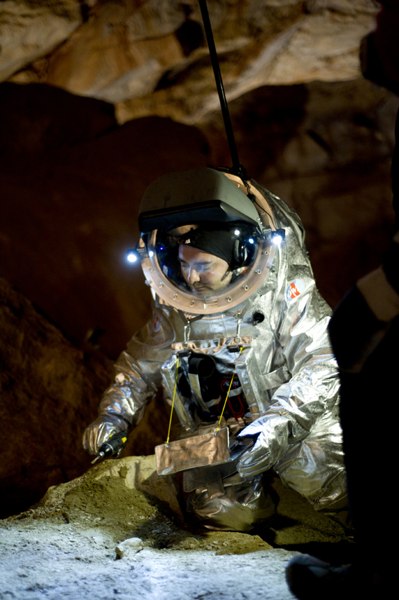 The Aouda.X spacesuit tests were part of a 5-day Mars mission analog field test performed at Mammoth Cave in the Giant Ice Caves of Dachstein, Austria, by the Austrian Space Forum and international research partners in April-May 2012. Suit tester Daniel Schildhammer takes samples at the Dachstein giant ice cave.
