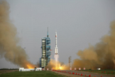 A Chinese Long March 2F rocket launches on the Shenzhou 9 mission, China's first manned space docking flight and first flight of a female astronaut, on June 16, 2012 from the Jiuquan Satellite Launch Center.