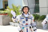 China's first female astronaut Liu Wang waves to supporters while clad in a spacesuit just before boarding the Shenzhou 9 space capsule for a successful June 19, 2012 launch from the Jiuquan Satellite Launch Center.