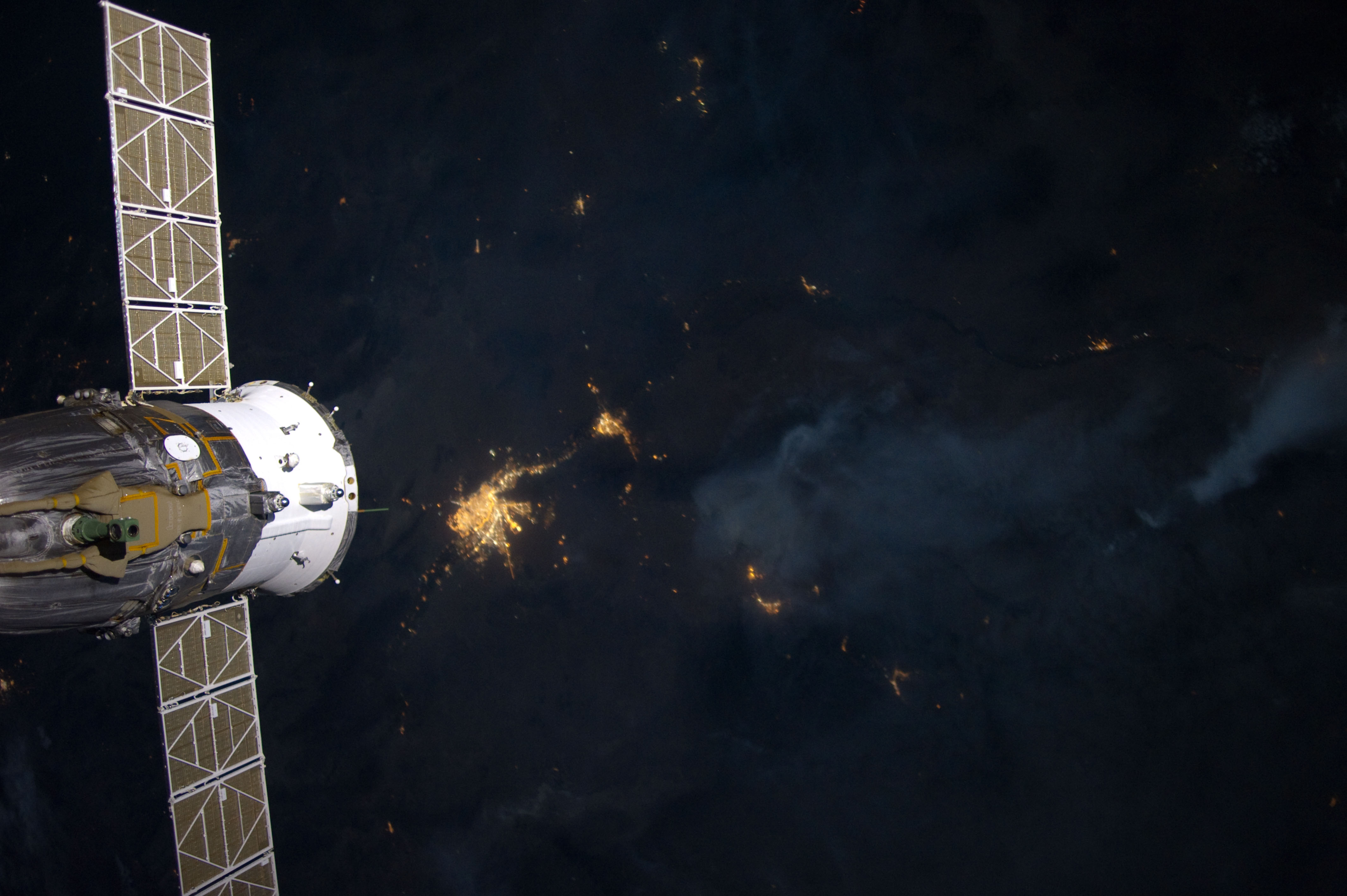 Fires with Soyuz Docked
