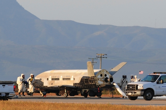 The Air Force's X-37B robotic space plane sits on the runway after landing at California's Vandenberg Air Force Base on June 16, 2012. The vehicle spent more than 15 months circling Earth on a mystery mission.