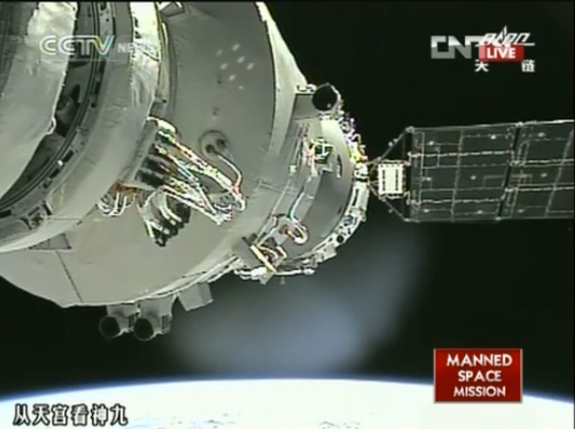 This still from a CNTV broadcast shows China's Shenzhou 9 space capsule just after it was manually docked to the Tiangong 1 space lab by astronaut Liu Wang on June 24, 2012.