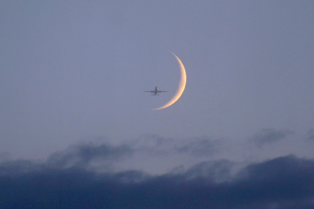 Airplane Joins Beautiful Crescent Moon in Night Sky Photo