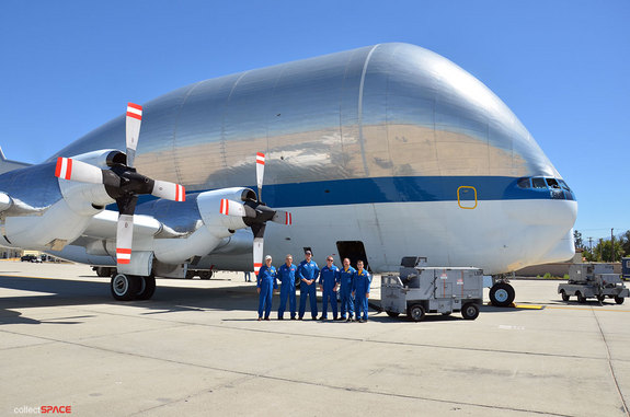 The Super Guppy flies with a crew of six: pilots Greg Johnson and Dick Clark, flight engineers David Elliott and Michael Robinson, aircraft mechanic Bob Coyne, electrician Dan Thompson and loadmaster Jon Myrick.