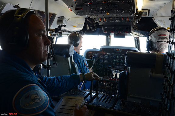 "NASA astronaut Greg C. ""Ray-J"" Johnson (left) and NASA pilot Dick Clark seen at the controls of the Super Guppy during its flight between air bases in California, June 28, 2012. Seated behind them is David Elliott, flight engineer."