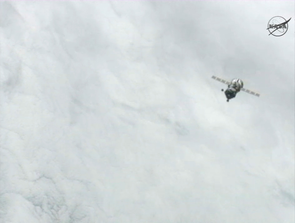 White Clouds and Expedition 31 Crew's Soyuz Capsule