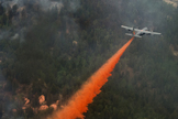 A U.S. Air Force C-130 Hercules aircraft uses a modular airborne firefighting system to spread fire retardant on the Waldo Canyon wildfire in Colorado Springs, Colo., on June 28, 2012. The Waldo Canyon fire, which started June 23, has burned several hundred homes and forced large-scale evacuations in Colorado Springs.