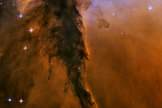 A tower of cold gas and dust rises from the Eagle Nebula.