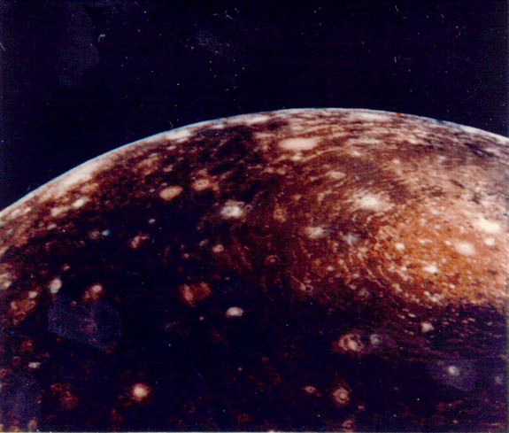 Voyager 1 image of Jupiter's moon Callisto from a distance of 350,000 km. The large 'bulls-eye' at the top is believed to be an impact basin formed early in Callisto's history. The bright center of the basin is about 600 km across and the outer ring is about 2,600 km across.