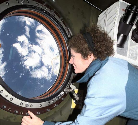 Astronaut Susan J. Helms, Expedition Two flight engineer, views the topography of a point on Earth from the nadir window in the U.S. Laboratory Destiny module of the International Space Station