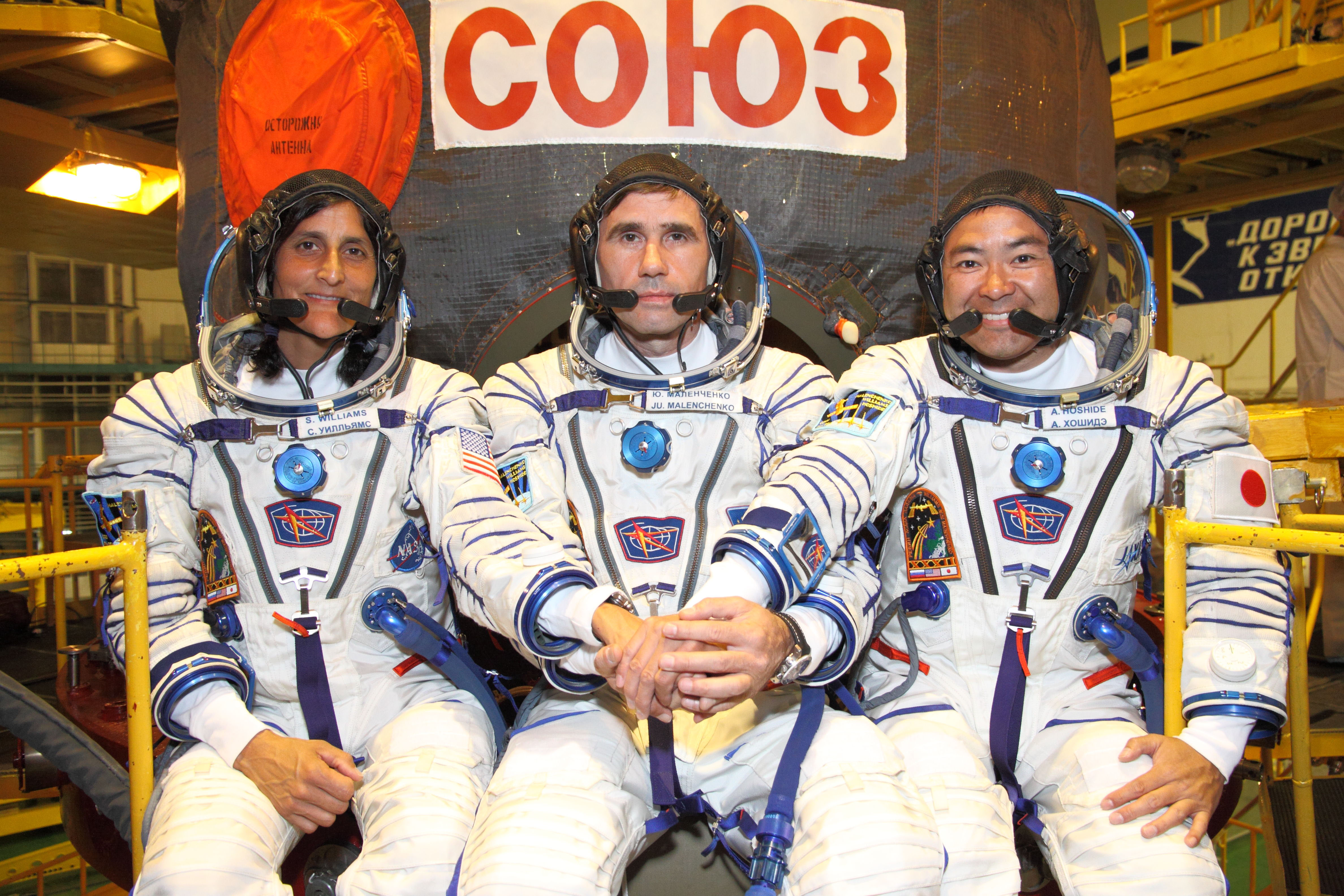 Suited up in Front of Soyuz