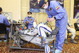 "At the Baikonur Cosmodrome in Kazakhstan, Expedition 32 Flight Engineer Sunita Williams participates in a leak check of her Russian launch and entry suit July 3, 2012 as part of the suited ""fit check"" of the Soyuz TMA-05M spacecraft."