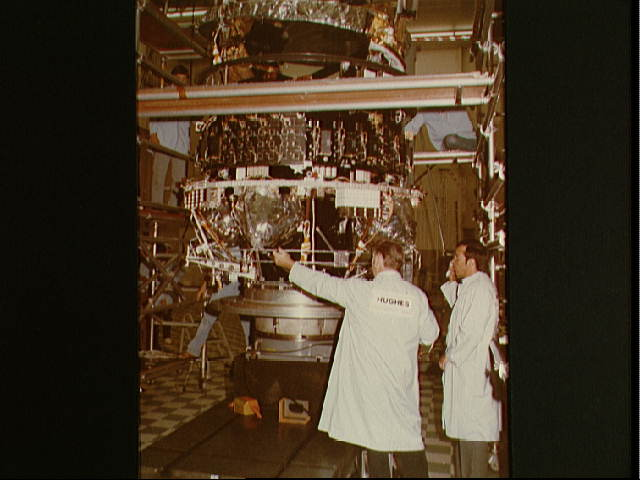 Hughes Aircraft Technicians Work on Telstar 3