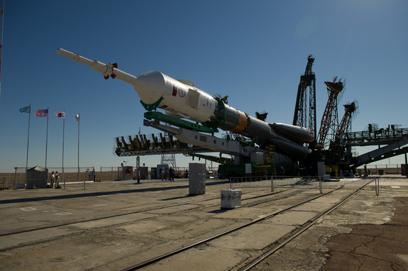 The Soyuz TMA-05M spacecraft is raised into position at the launch pad at the Baikonur Cosmodrome in Kazakhstan, Thursday, July 12, 2012.