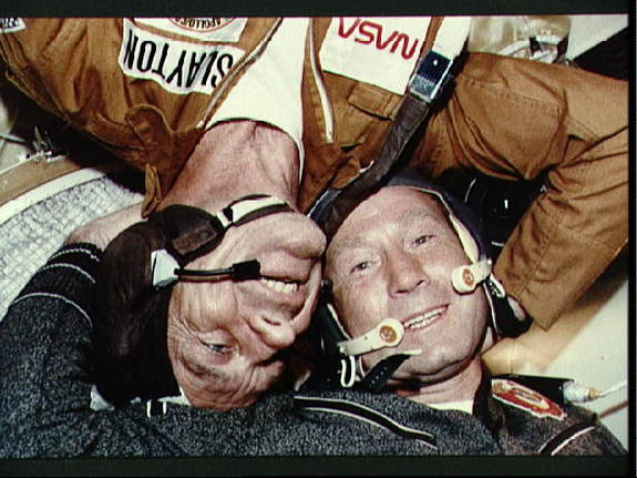 Astronaut Deke Slayton (left) and Cosmonaut Aleksey A. Leonov are photographed together in the Soyuz Orbital Module during the joint U.S.-USSR Apollo Soyuz Test Project (ASTP) docking in Earth orbit mission. They are the respective commanders of their crews.
