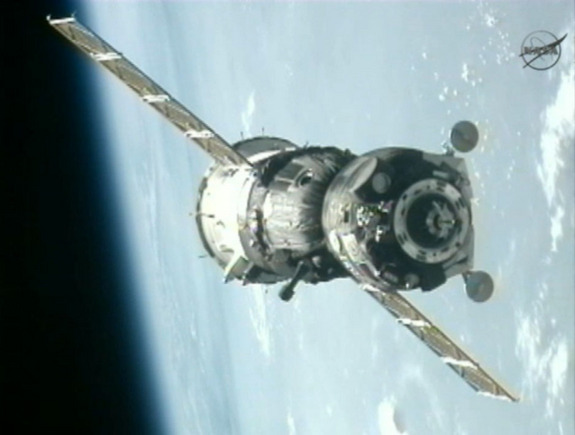 A Russian Soyuz TMA-05M spacecraft nears the International Space Station with the blue Earth in the background in this view from a station camera during a July 17, 2012 docking of the Expedition 32 crew.