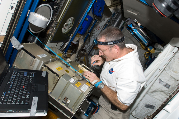 NASA astronaut Dan Burbank, Expedition 30 commander, works with the Major Constituent Analyzer Mass Spectrometer Assembly (MCA MSA) of the Atmosphere Revitalization system in the Tranquility node of the International Space Station. In the future, made-in-space parts may become the norm to fix equipment on the fritz.