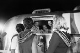 Apollo 11 astronauts, still in their quarantine van, are greeted by their wives upon arrival at Ellington Air Force Base on July 27, 1969.