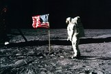 Apollo 11 astronaut Buzz Aldrin poses with the American flag on the surface of the moon in July 1969.