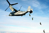 Paratroopers deploy from a V-22 Osprey.