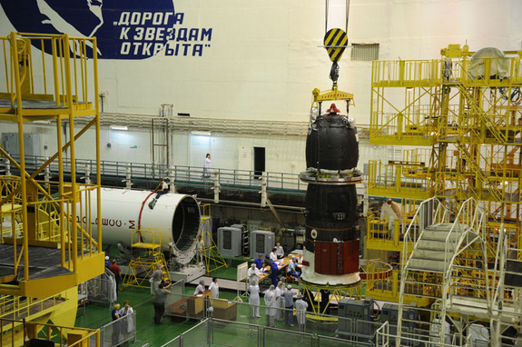 The Russian Progress 48 supply ship is prepared for its Aug. 1, 2012 launch. The spacecraft will launch and dock with the International Space Station in an unprecedented test flight.