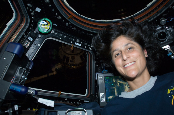 NASA astronaut Sunita Williams, Expedition 32 flight engineer, is pictured in the Cupola of the International Space Station during rendezvous operations with the unpiloted Japan Aerospace Exploration Agency (JAXA) H-II Transfer Vehicle (HTV-3). This image was taken July 27, 2012.