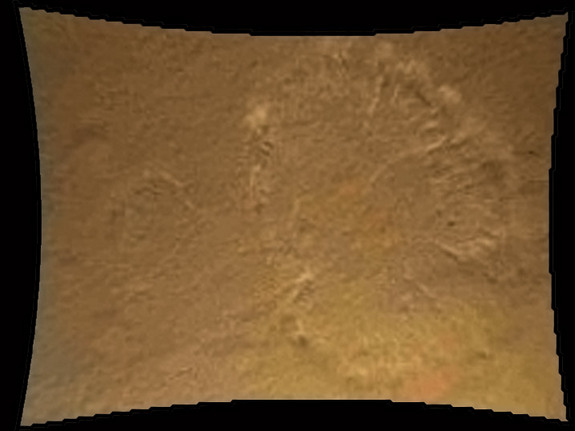 This image from Curiosity's Mars Descent Imager illustrates the roughly circular swirls of dust kicked up from the Martian surface by the rocket motor exhaust. At this point, Curiosity is about 70 feet (20 meters) above the surface. This dust cloud was generated when the Curiosity rover was being lowered to the surface while the sky crane hovered above. Curiosity landed on Mars on the night of Aug. 5, and this photo was released by NASA on Aug. 6, 2012.