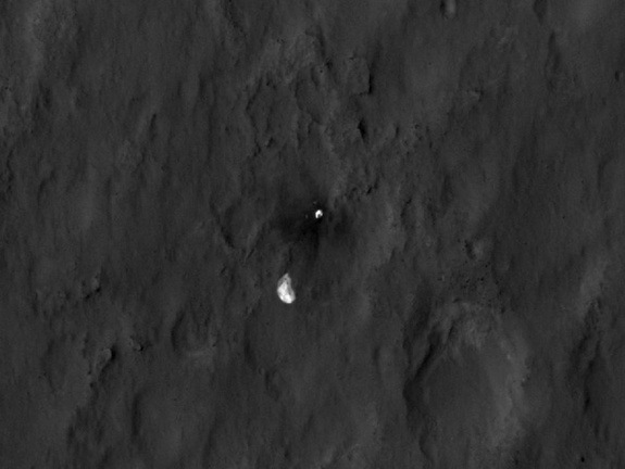 The parachute and backshell of NASA's Mars rover Curiosity are seen in this photo from the Mars Reconnaissance Orbiter released on Aug. 7, 2012. Curiosity landed on Mars on Aug. 5 PDT.