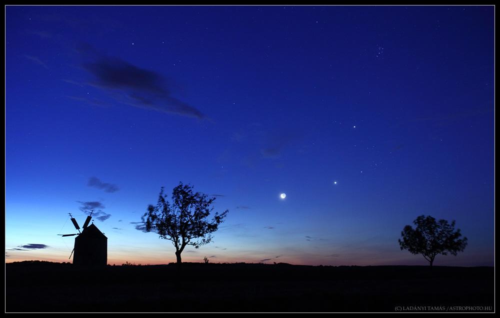 Dazzling Night Sky Over Historic Windmill (Photo)