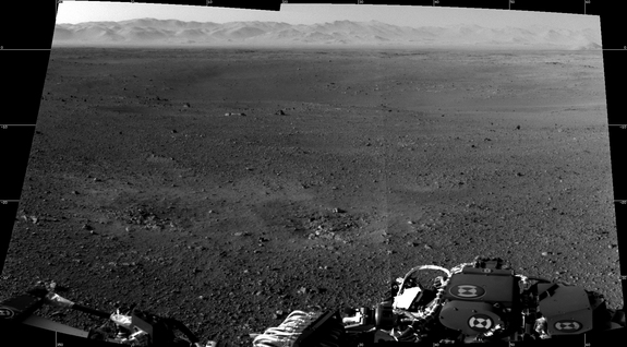 "These are the first two full-resolution images of the Martian surface from the Navigation cameras on NASA's Curiosity rover, which are located on the rover's ""head"" or mast. The rim of Gale Crater can be seen in the distance beyond the pebbly ground. Images released Aug. 8, 2012."