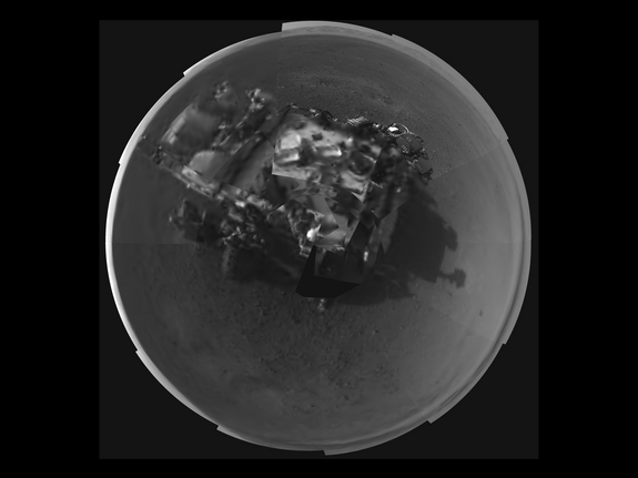 This Picasso-like self portrait of NASA's Curiosity rover was taken by its Navigation cameras, located on the now-upright mast. The camera snapped pictures 360-degrees around the rover, while pointing down at the rover deck, up and straight ahead. Only 2 tiles are high-resolution at this point. (Released Aug. 8, 2012)