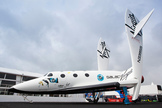 A replica of the Virgin Galactic Spaceship Two sits at the Farnborough International Airshow, Hampshire, England. The image was taken July 9, 2012.