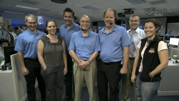 "The team behind NASA's Mars rover Curiosity's Aug. 5 landing take a call from President Barack Obama on Aug. 13, 2012. At center is NASA Jet Propulsion Laboratory director Charles Elachi. Obama called the Mars landing ""mindboggling."""
