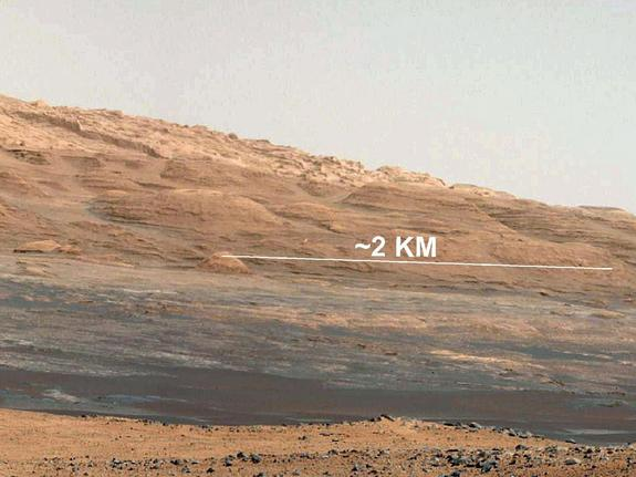 This image (cut out from a mosaic) shows the view from NASA's Mars rover Curiosity landing site toward the lower reaches of Mount Sharp, where the rover will likely start its ascent through hundreds of feet (meters) of layered deposits.  Image taken on Aug. 8, 2012, released Aug. 17.