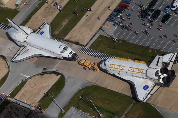 "NASA's space shuttles Endeavour and Atlantis switched locations August 16, 2012, at Kennedy Space Center in Florida, and in the process came ""nose-to-nose"" for the last time in front of Orbiter Processing Facility 3."