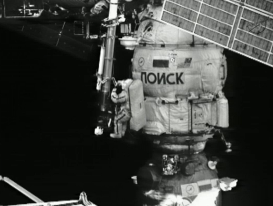 Cosmonaut Works on Crane Outside ISS