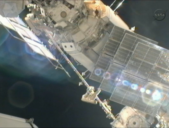 Cosmonauts Gennady Padalka (left) and Yuri Malenchenko work to move a crane outside the International Space Station during a spacewalk on Aug. 20, 2012, in this still image from a video camera on the station.
